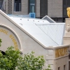 Building roof top with statue of a golden ram