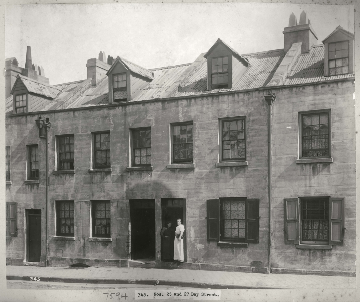 Black and white photograph of terraced building fronts.