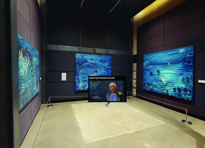 Gallery showing three large blue paintings from the Invasion series by Gordon Syron