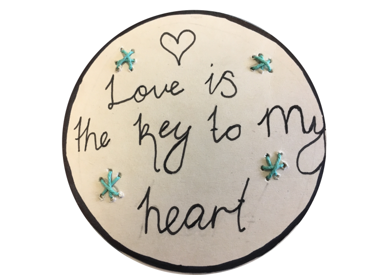 Artwork on paper or card depicting student interpretation of coin-shaped love token.