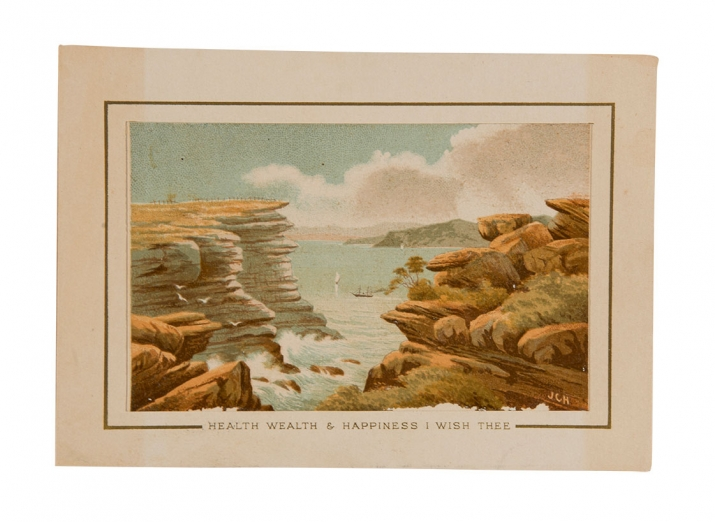 Discoloured image from scrap album of sandstone landscape, with sea in background.