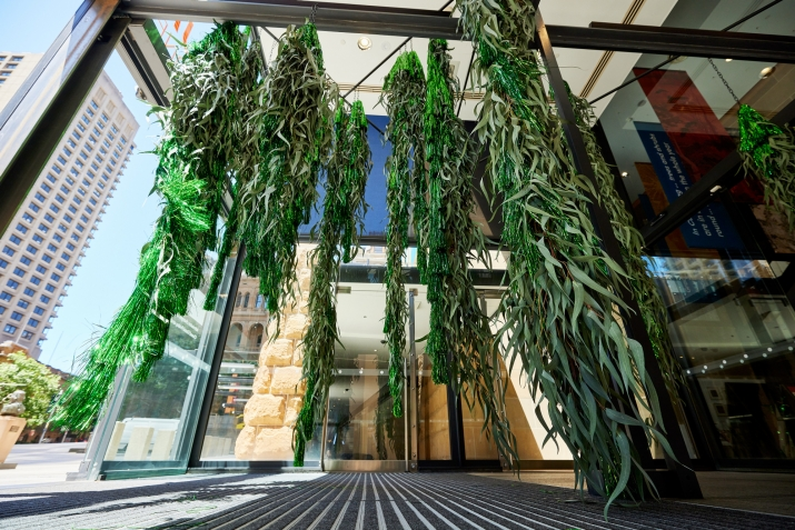 Foliage installation hanging from the ceiling to the floor at the entry to the Museum of Sydney