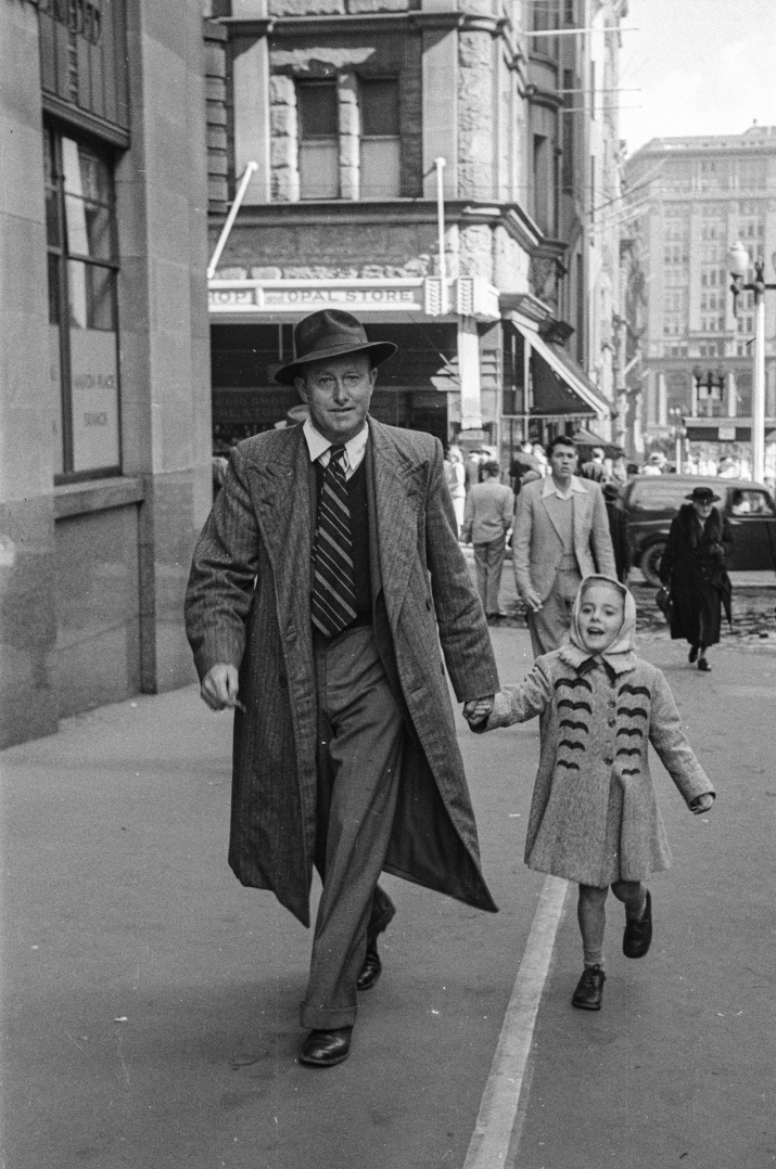Black and white street photograph of pedestrians