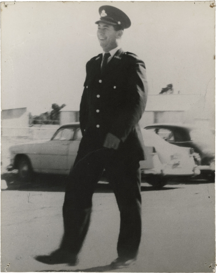 Black and white photo of man in uniform with cap.