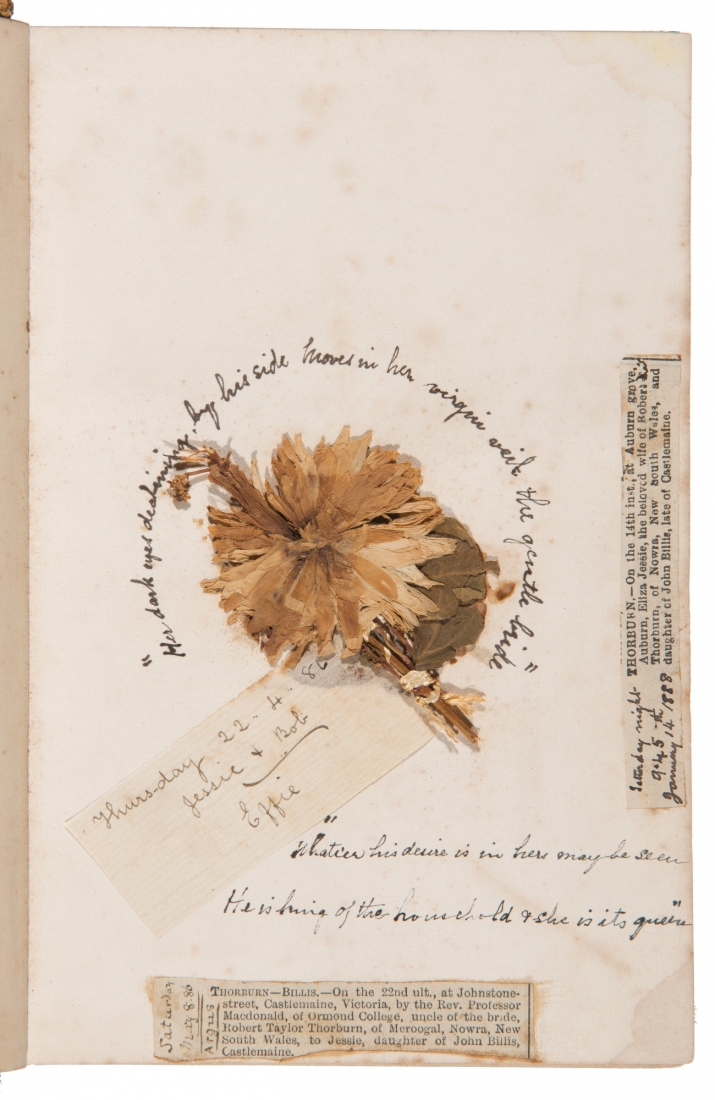Dried flower inside book cover, with handwritten inscriptions and signatures.