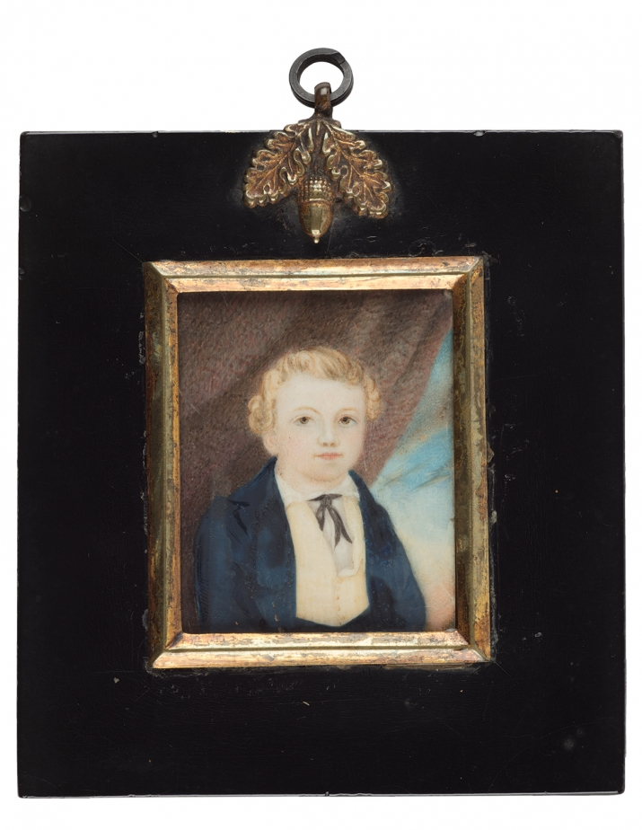 Portrait of man in black bordered frame.