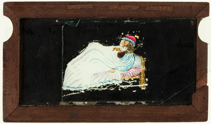 A timber framed glass magic lantern slide featuring a hand-drawn and coloured image of a man in bed with a rat running into his mouth. Secondary (hinged) and tertiary (sliding) glass plates open and close his mouth and move the rat.