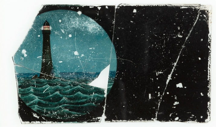 A broken glass panel from a magic lantern slide featuring a hand-drawn and coloured night view of a lighthouse on a storm-wracked coastline. The slide is broken into four pieces with some sections missing.