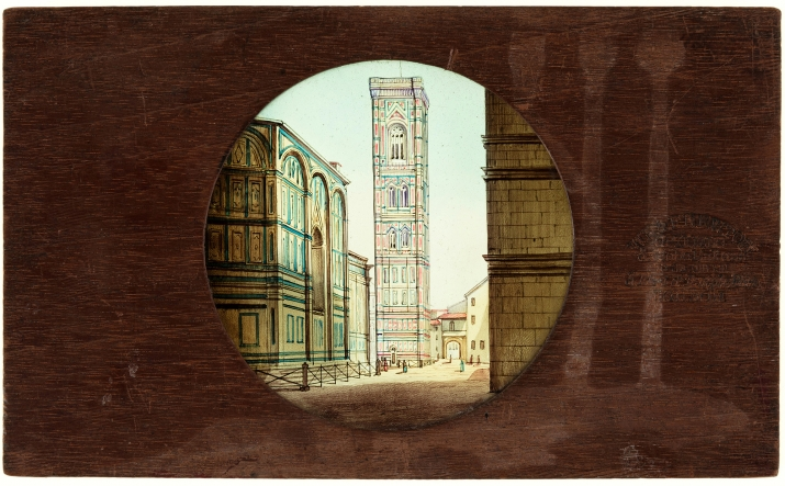 A timber framed, circular glass, static lantern slide featuring a hand painted scene of Florence.