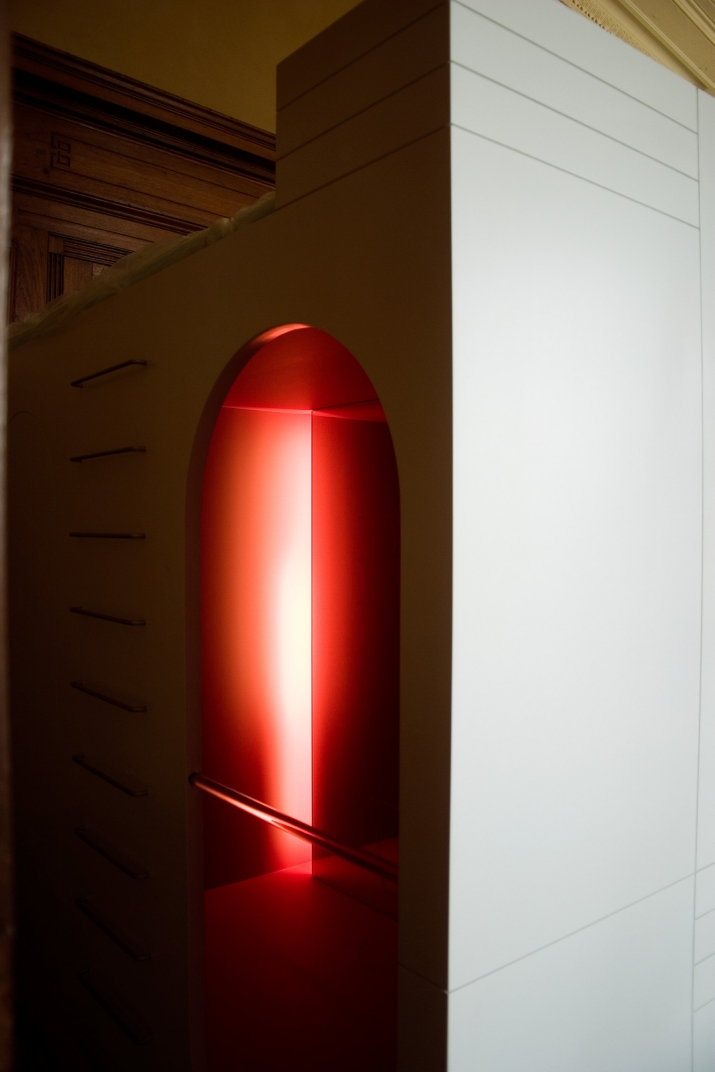 View into a box like construction with a red light inside