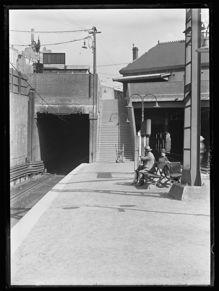 Black and white photo of platform with tunnel to left.