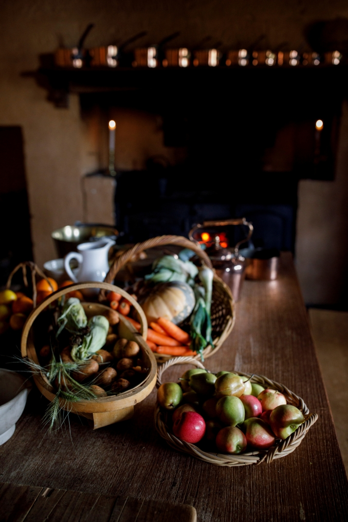 Fruit and vegetables arranged on wooden table.