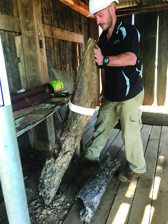 Joiner holding a timber strut