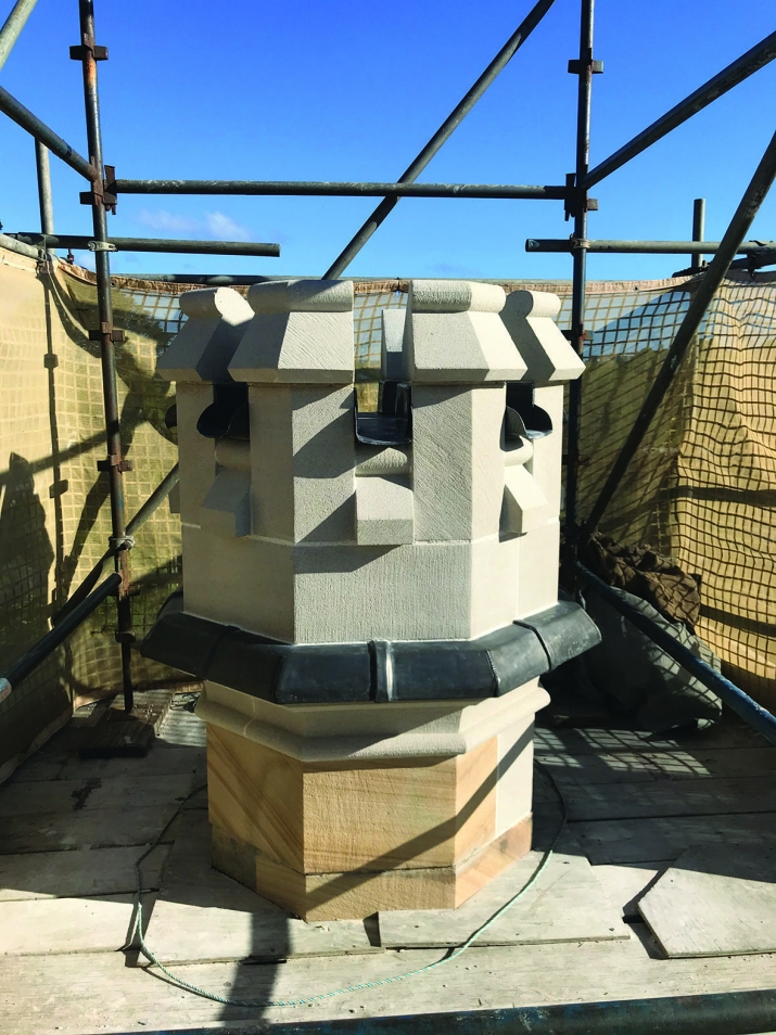 Newly installed turret with scaffolding behind.
