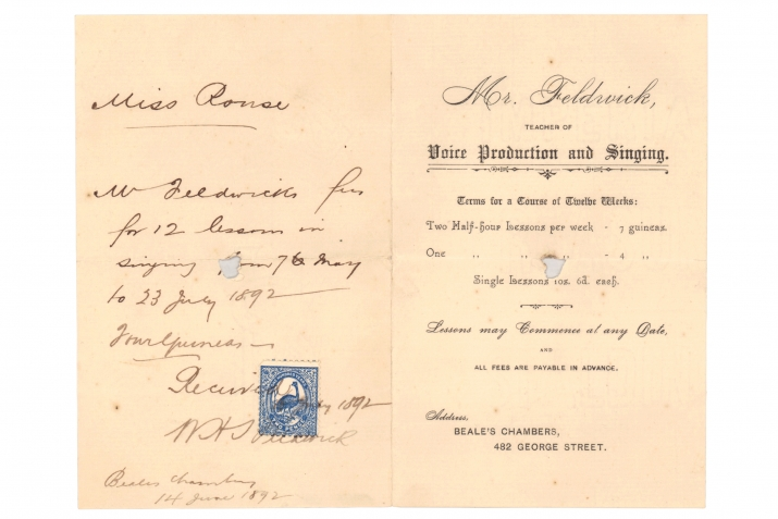 Handwritten receipt with blue stamp imprint.