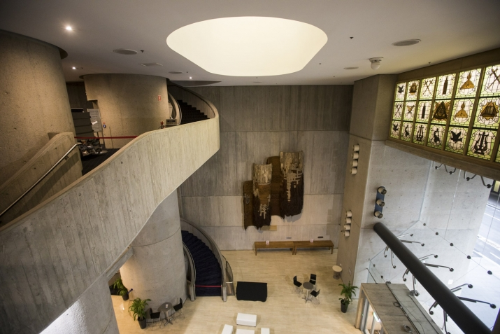 Interior of rounded concrete interior with curved stair.