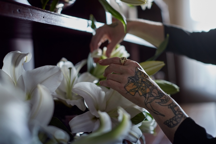 A close up of Lillies in the buffet and Doctor Cooper's hands in the Vaucluse House kitchen