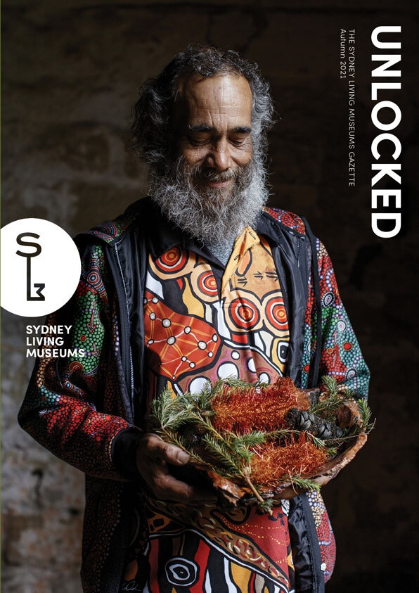 Cover of magazine showing man in colourful patterned shirt.