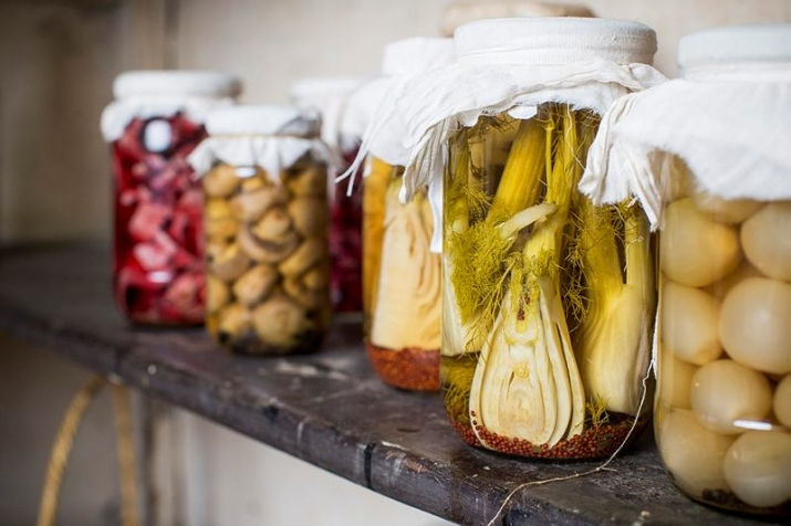 Jars of pickled vegetables on a shelf
