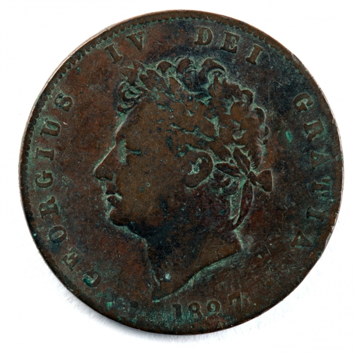 Discoloured coin with king's head.