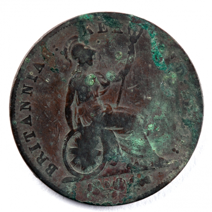 Discoloured coin inscribed with female figure in chariot.