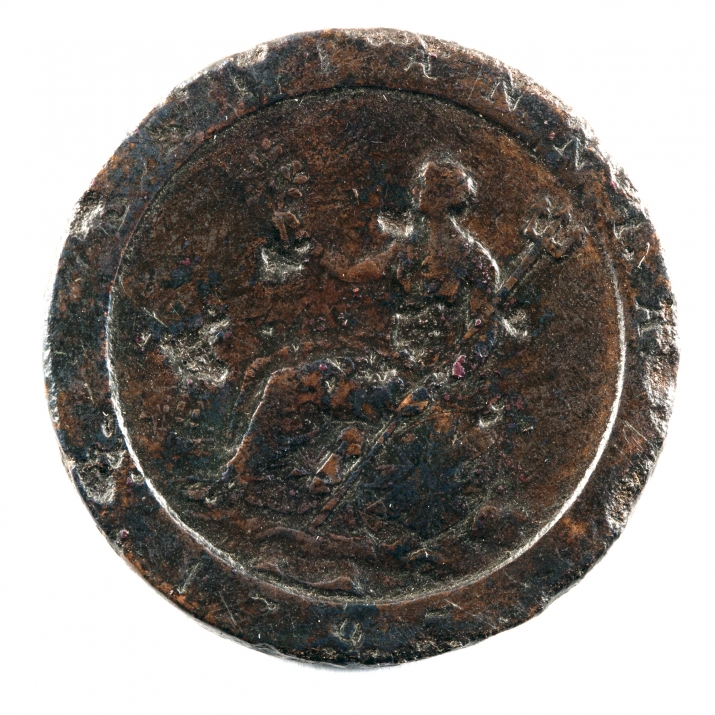 Old, pitted coin with figure of woman.