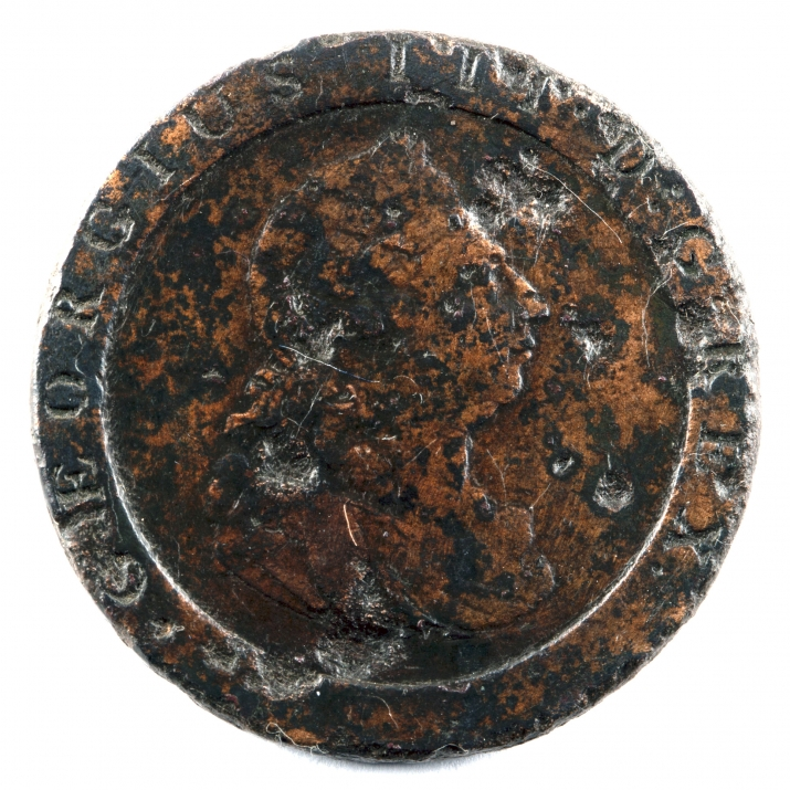 Old pitted coin with head of man.