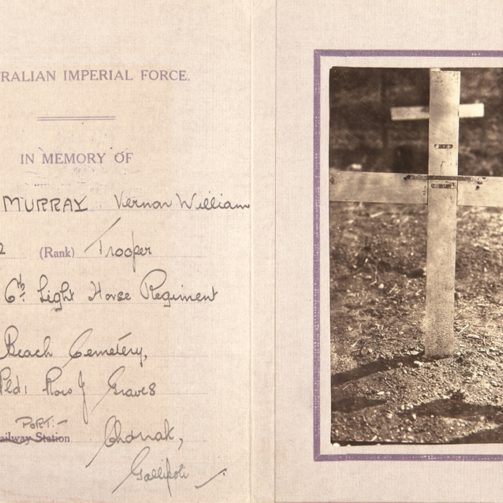 Open booklet with handwriting on left page and photo of grave marker on right.