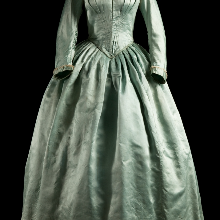 Greenish satin sheened gown.