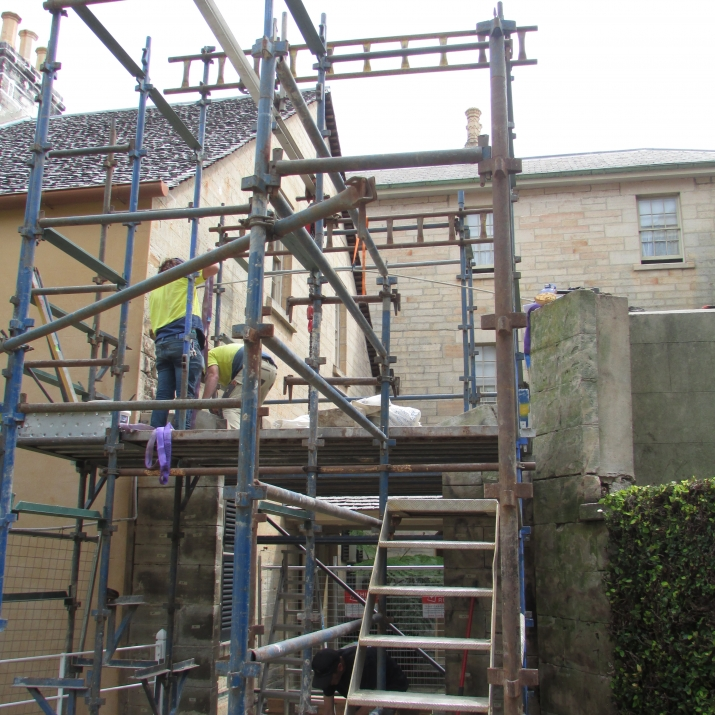 Scaffolding around part of building.