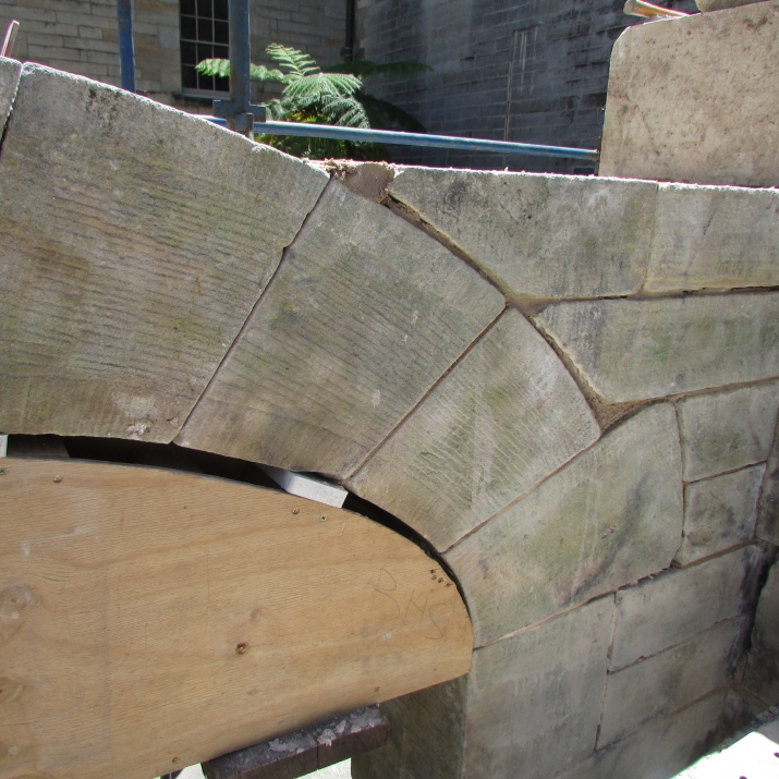 Archway with piece of wood supporting.