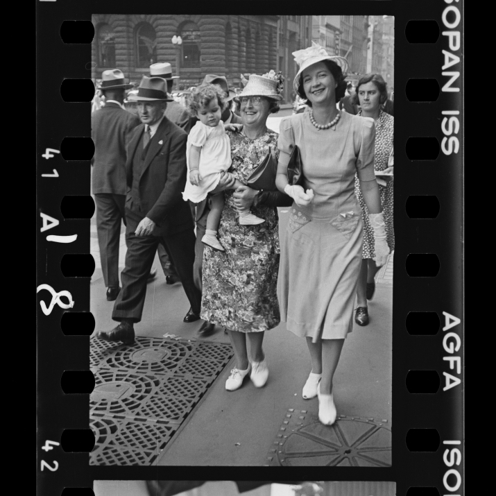 Piece of black and white photographic film showing pedestrians.