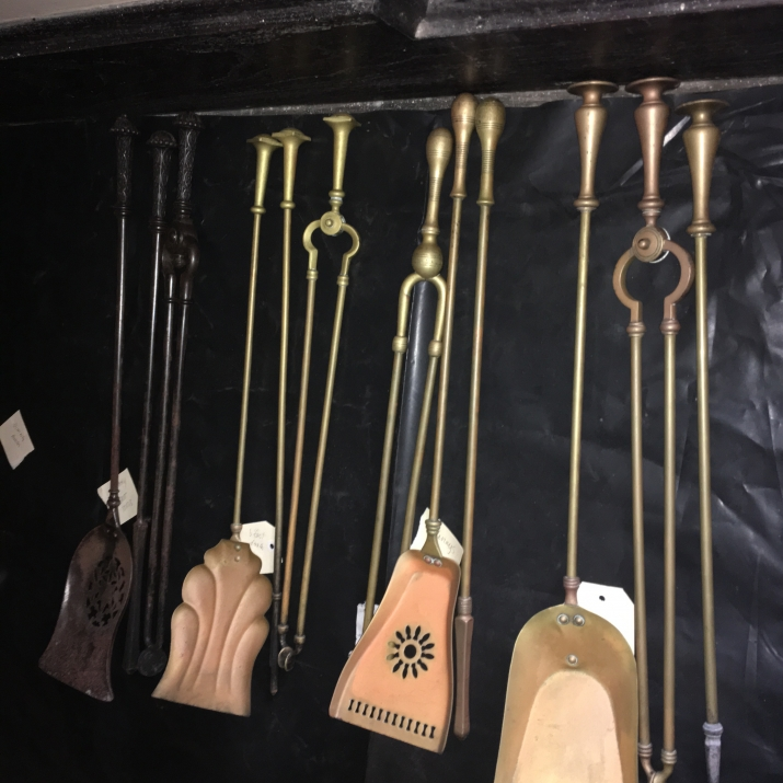 Group of pokers, shovels and other metal fire tools.