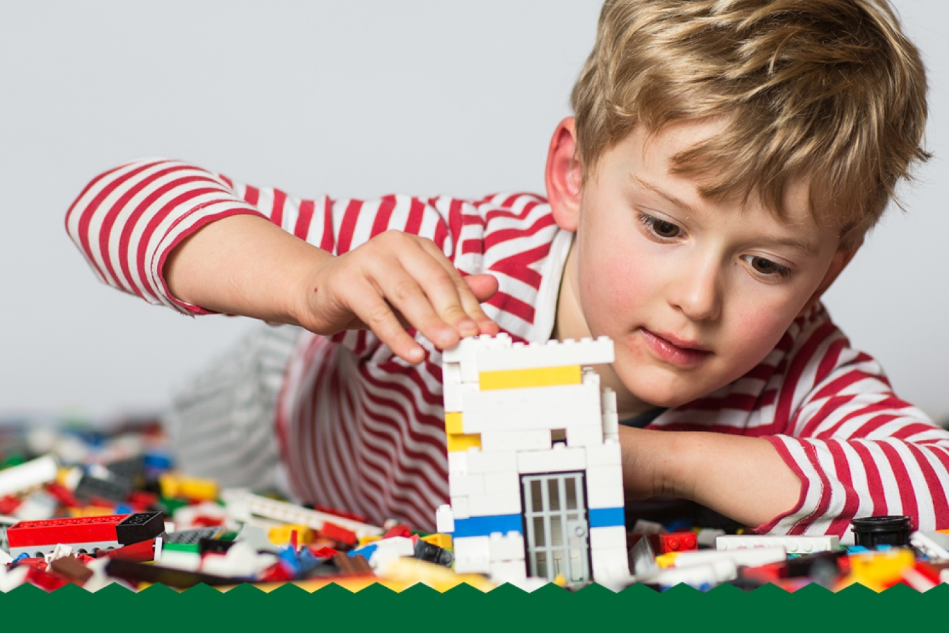 Boy playing with LEGO.