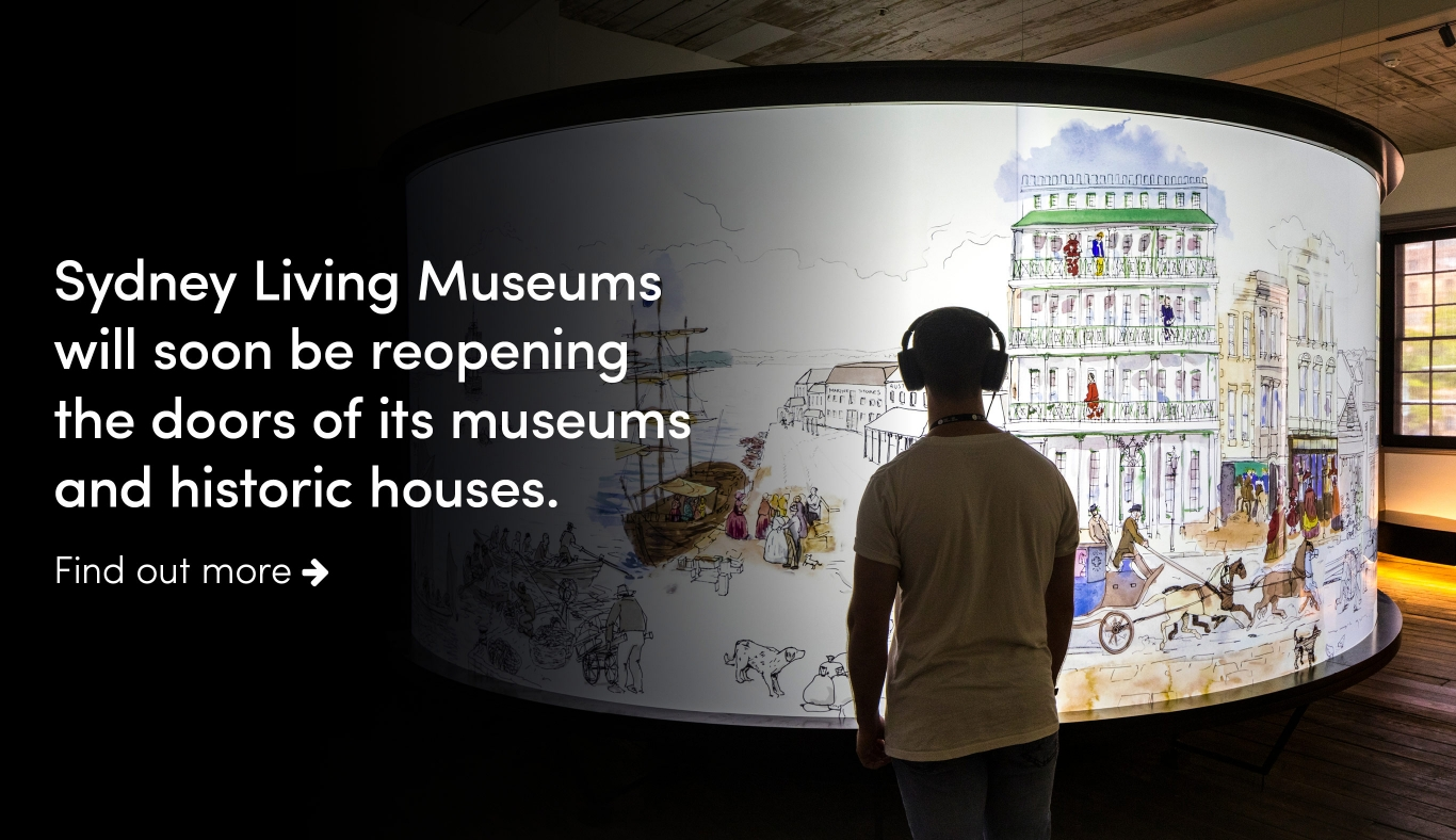 Text overlaying image of person looking at interactive.