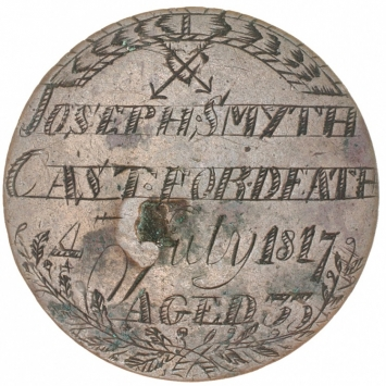Coin engraved with inscription.