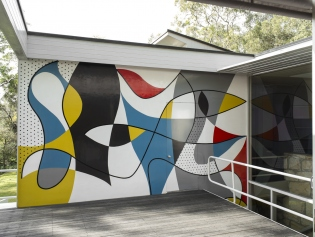 View of mural taken on sun deck showing primary colour scheme within a bold black pattern.